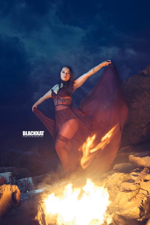 Catching Fire    by BlackKat Photography , Maryanne Meservey , Marina Bina